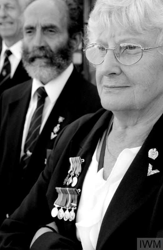 The widow of a Second World War serviceman wears his medals at the Victory and Freedom Parade organised in Newbury, Berkshire to commemorate the 60th anniversary of the end of the Second World War. Similar events took place throughout Britain. © Crown Copyright. IWM (HU 94254)